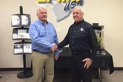 Tom Charlton, president of Electronic Coating Technologies shakes hands with Mike Cooper, president of LPMS-USA.