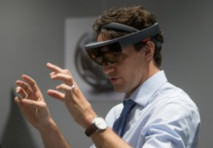Prime Minister Justin Trudeau experiences Microsoft HoloLens at the official opening of the Microsoft Canada Excellence Centre in Vancouver. The facility is designed to be an incubator of new technological talent and innovation.