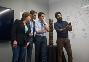Preet Mangat, senior program manager Microsoft Canada, demonstrates City Hacks with Rt. Hon. Justin Trudeau, Prime Minister of Canada, the Hon. Christy Clark, the Premier of British Columbia and Mayor Gregor Robertson, for the City of Vancouver at the Microsoft Canada Excellence Centre.