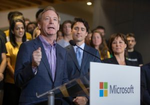 Canadian Prime Minister Justin Trudeau and Microsoft president Brad Smith speak at the opening of the Microsoft Canada Excellence Centre.