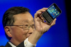 """John Chen introducing the Classic in 2014. A company official now says that """"the Classic has long surpassed the average lifespan for a smartphone in today's market."""" (BRENDAN MCDERMID / REUTERS)"""