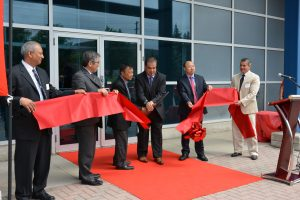 Murata Power Solutions president and CEO Stephen Pimpis (3rd from right) leads the ribbon cutting ceremony at the firm's expanded Markham ON facility.
