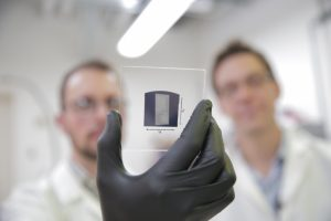 The UW–Madison engineers use a solution process to deposit aligned arrays of carbon nanotubes onto 1 inch by 1 inch substrates. The researchers used their scalable and rapid deposition process to coat the entire surface of this substrate with aligned carbon nanotubes in less than 5 minutes. The team's breakthrough could pave the way for carbon nanotube transistors to replace silicon transistors, and is particularly promising for wireless communications technologies. (Photo: Stephanie Precourt/UW–Madison College of Engineering)