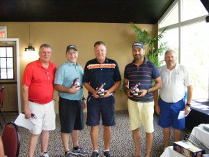 The winning foursome was comprised of John Miekle, TCH; Kevin Wilkinson, Panduit; Harry Coates, Schleuniger; and Paul Mudhar, X-Tronics. The foursome is pictured with Tim Dawe, one of the event organizers.