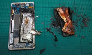 A Samsung Note 7 handset is pictured next to its charred battery after catching fire during a test at the Applied Energy Hub battery laboratory in Singapore. The company has now suspended production of the phone. Photograph: Edgar Su/Reuters