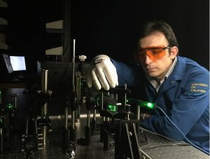 Fariborz Kargar, a graduate student researcher, is measuring the acoustic phonon dispersion in the semiconductor nanowires in UCR's phonon optimized engineered materials (POEM) Center, directed by Alexander Baladin. (Photo credit by University of California – Riverside).